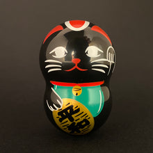 "Load image into Gallery viewer, Wobbly black maneki neko ""world peace"""