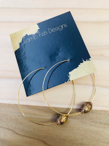 Gold bead accents on hoop earrings
