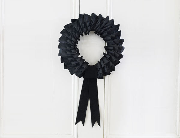 Black Crepe Paper Wreath - An Elegant Crawl Welcomes Guests