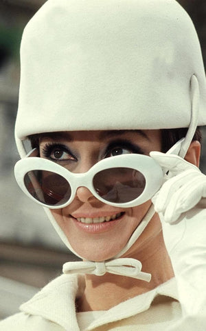 Audrey Hepburn wearing white clout glasses