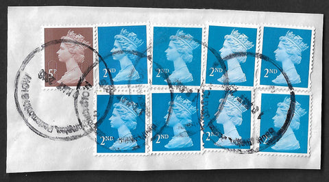 GB 2nd class machin stamps x 8 and 5p machin used on small piece.