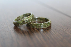 Two Green Cannabis Resin Rings filled with Marijuana and Hemp