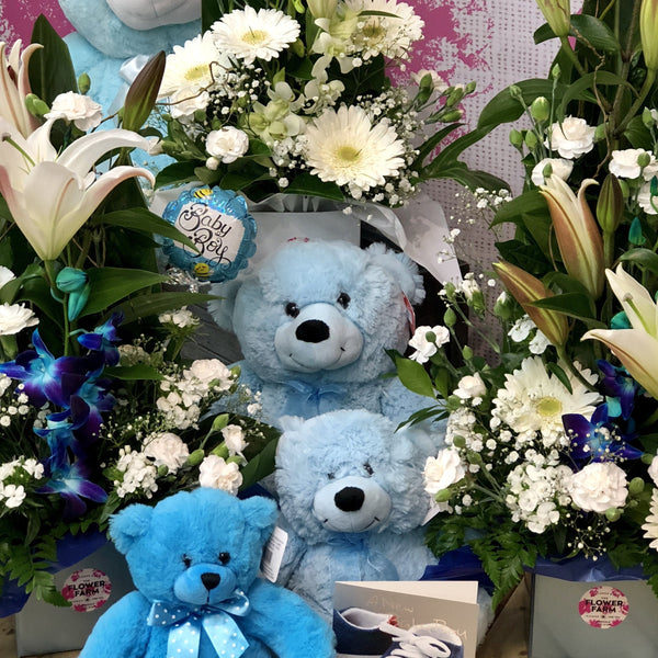 Blue and white themed flowers, teddy and gift for a new baby boy.
