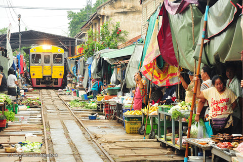 THE FAMOUS MAEKLONG TRAIN MARKET