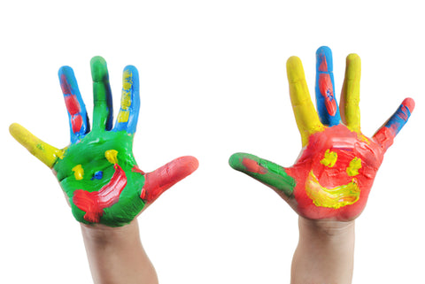 Palm of children's hands with colourful paint on