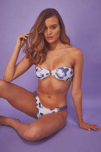 Model wears blue leopard eco bandeau