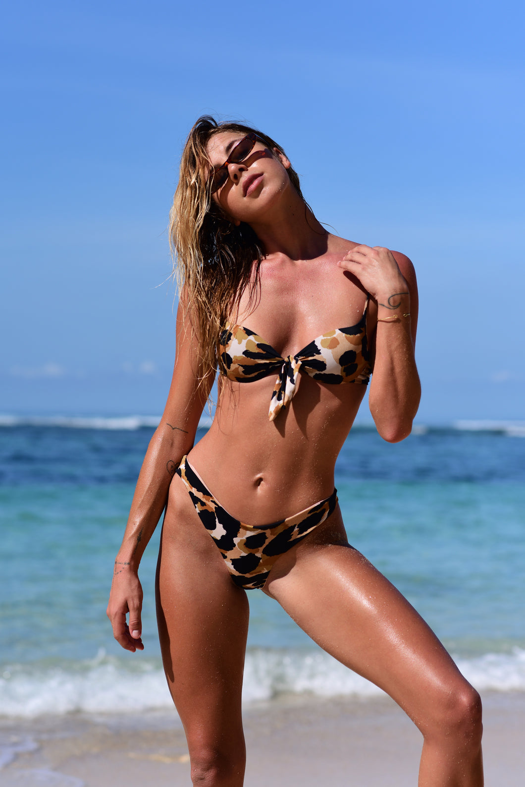 model wears push-up jaguar bikini top