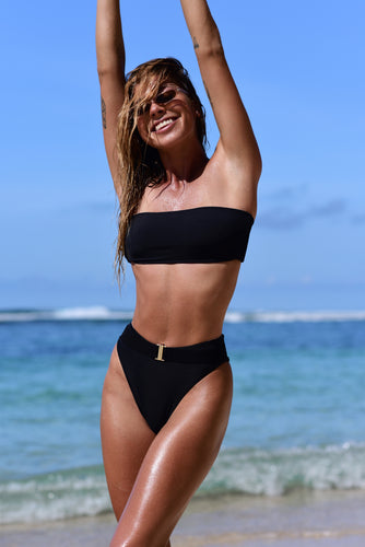 model wears black b52 bikini top