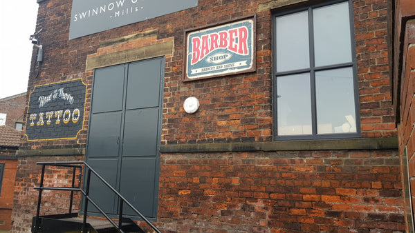 Custom fabricated rusty metal sign for Barber Shop