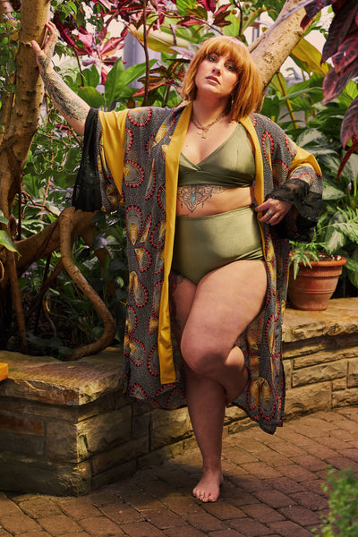 women wearing high waisted bikini bottom with adjustable top in a shinny khaki colour with kimono cover up