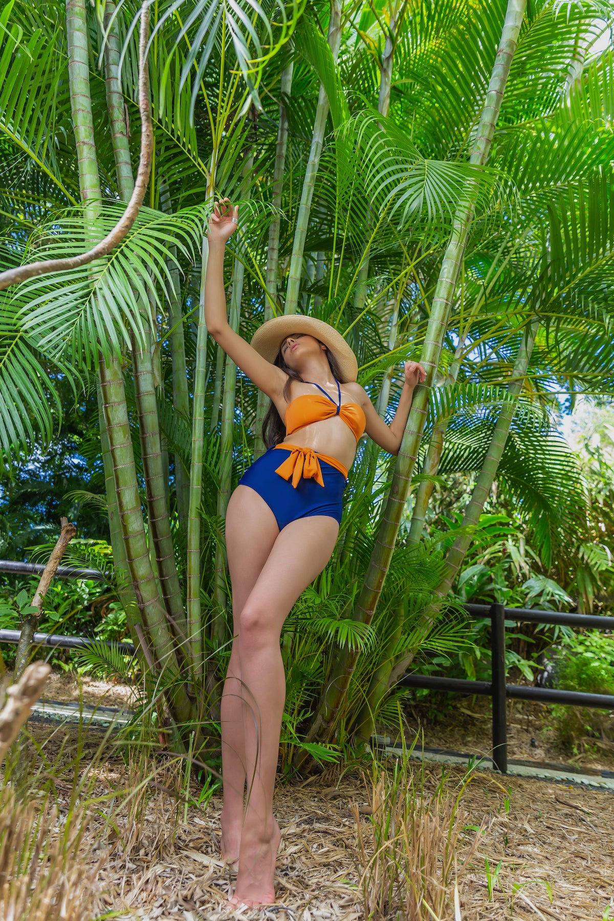Orange bandeau top and navy blue high waist bikini bottom made of recycled fibres fabric