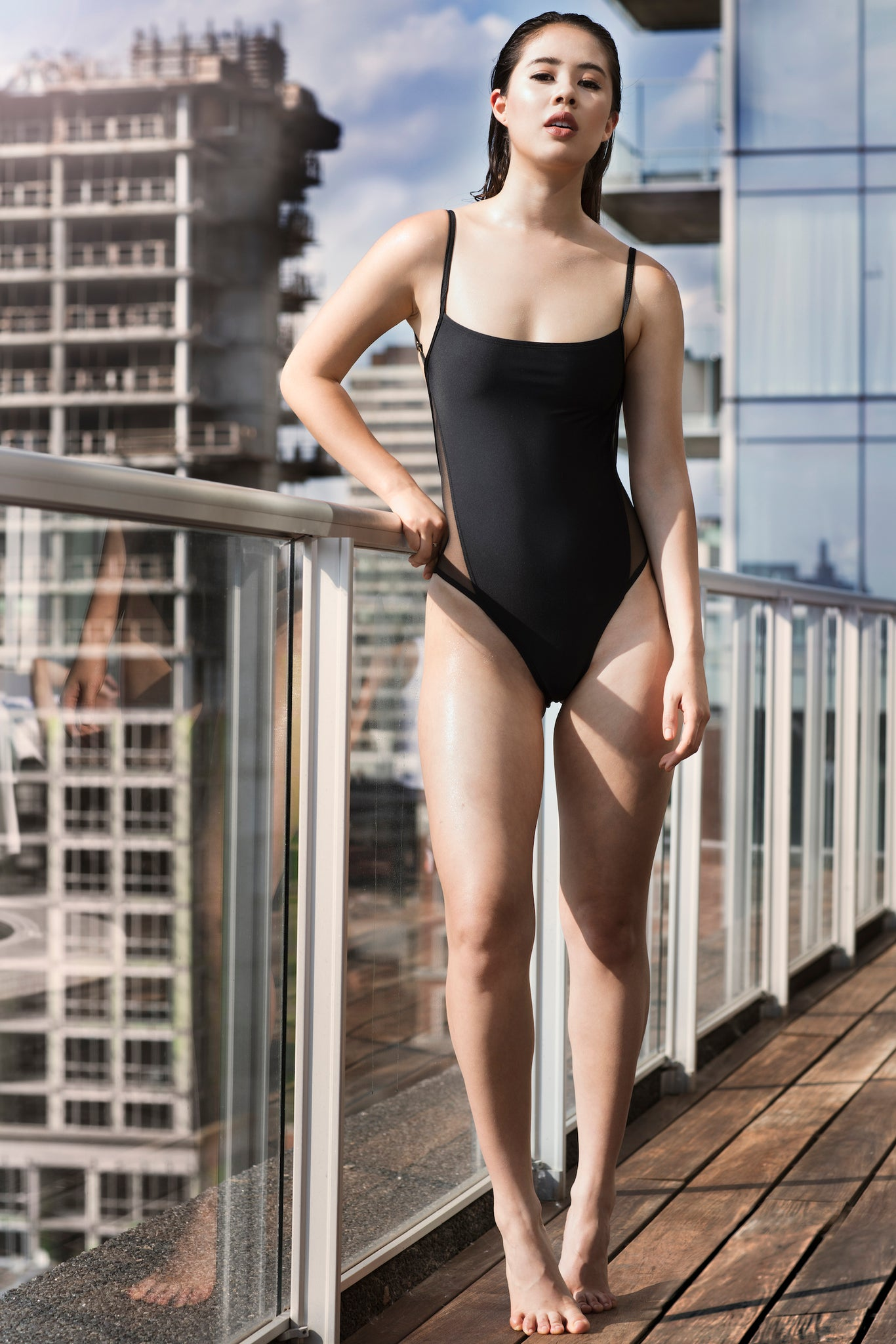 Black one piece swimsuit with side mesh