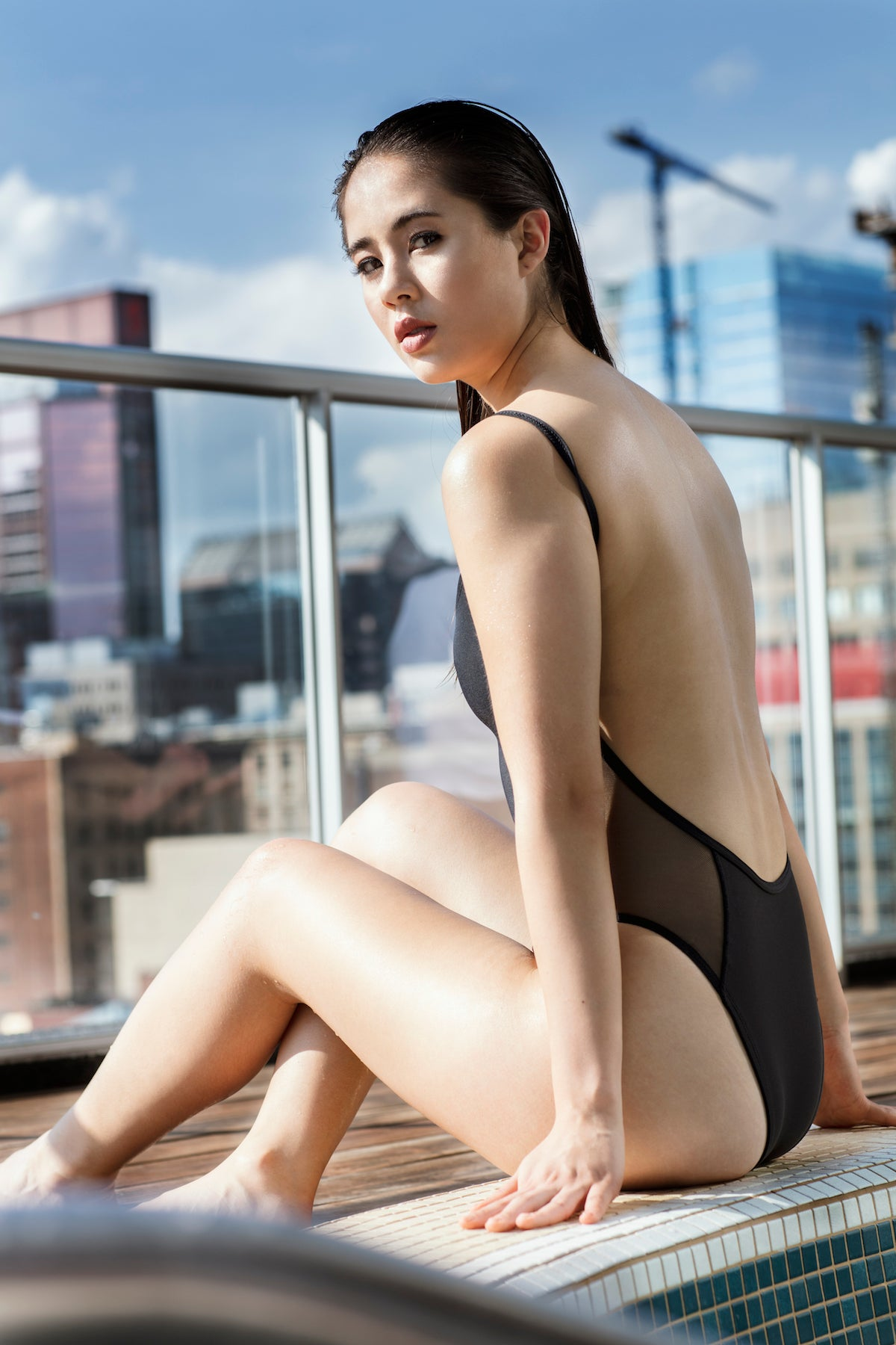 Black one piece swimsuit with side mesh and open back
