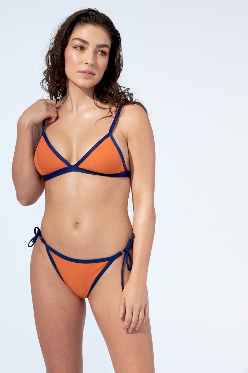 Bralette bikini top in orange with navy blue piping