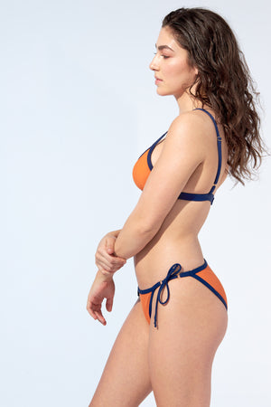 Bralette bikini top and tied bottom in orange with navy blue piping