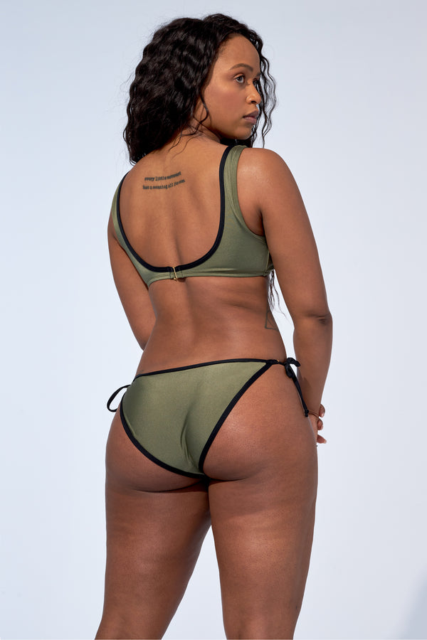 Bikini sporty top named Gabrielle with tied side bikini bottom called Rebecca. Bikini set in a shinny khaki colour with black trims.