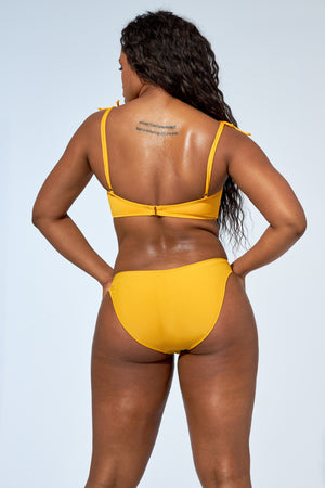 Yellow bikini set. Bandeau top and indented low rise bottom swimsuit.