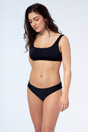 black bikini set, reversible low rise bikini bottom in black and stripes. Made of recycled fibres nylon imported from Italy