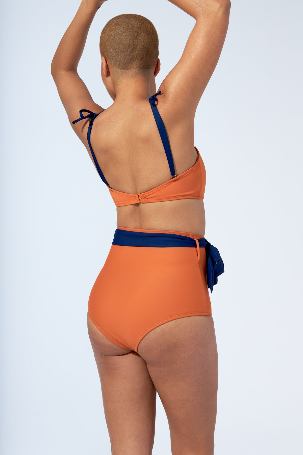 Orange and navy blue bikini set. Bandeau top and high waist retro bottom with belt swimsuit.
