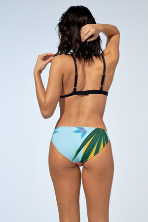 Women wearing tropical and colorful printed bikini set