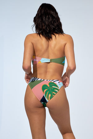 Women wearing low rise bikini bottom and strapless top in a colourful tropical print.