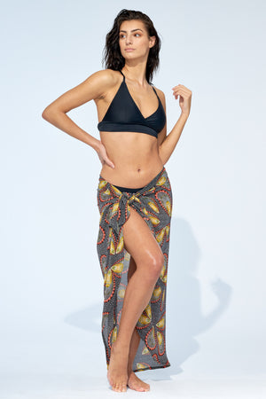 Women wearing black bikini with paisley wrap around pareo skirt cover up.
