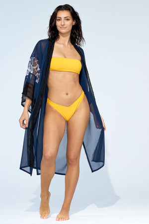 Women wearing beach kimono cover up on top of yellow bikini set.t.