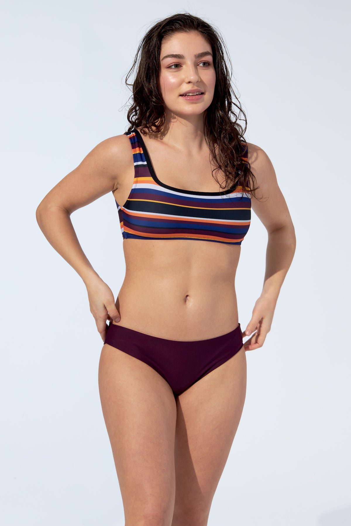 Women wearing striped bikini top and reversible bottom