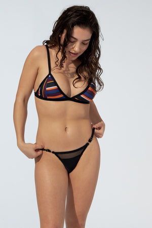 Women wearing striped bikini bralette top and sexy black bottom
