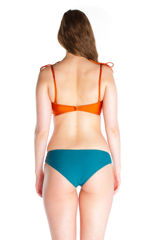 Low rise reversible cheeky bikini bottom in turquoise and tie-dye recycled fibres nylon