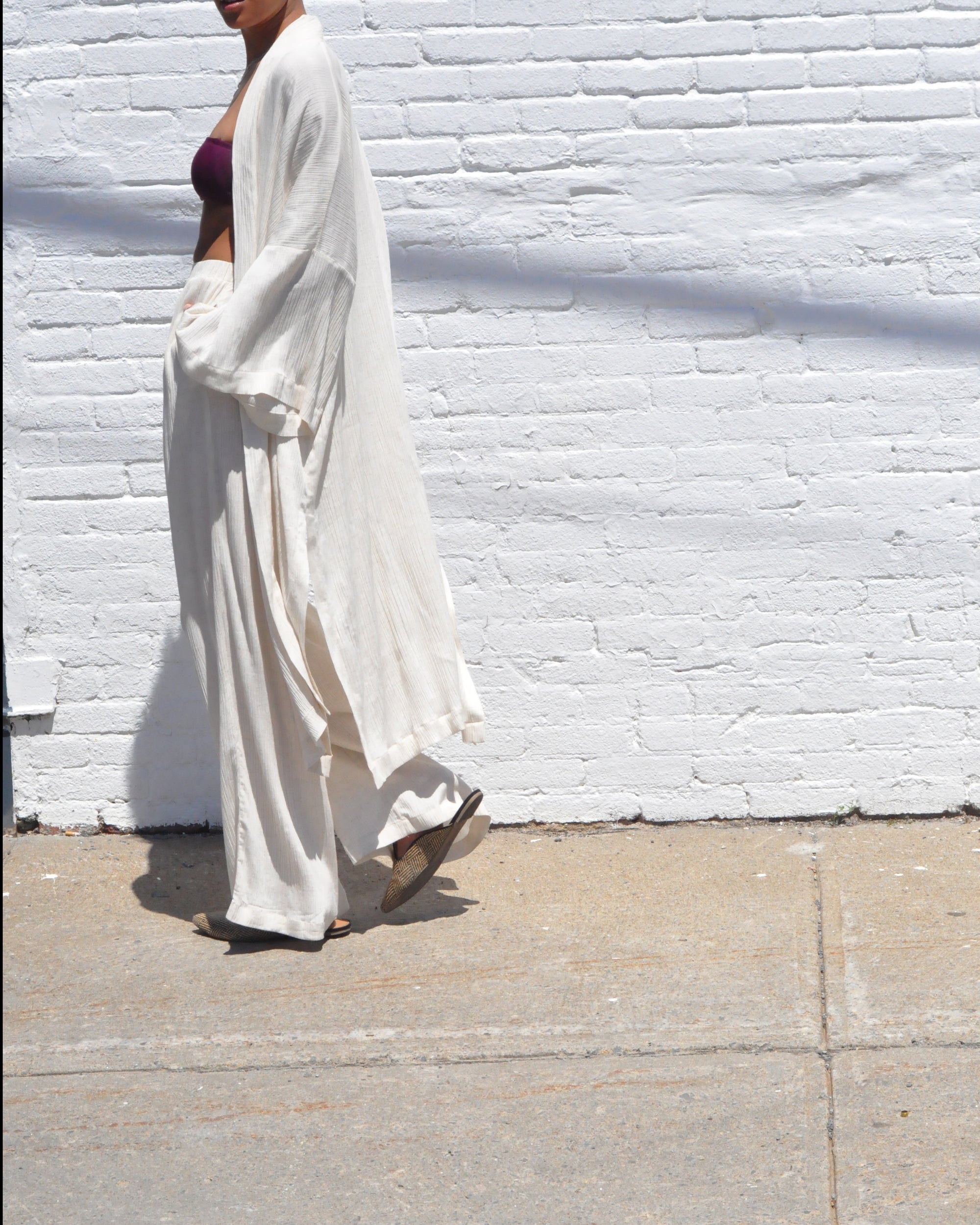 Women wearing creme kimono and palazzo pants