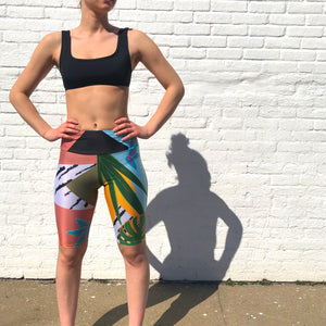 Women wearing colourful cyclist short and sporty black bikini top