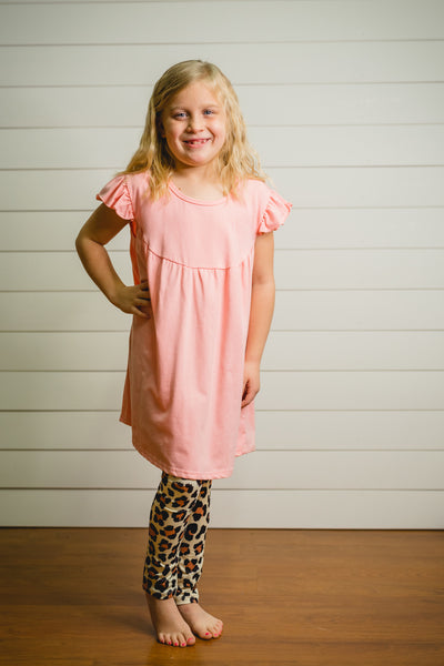 Sally's light pink tunic