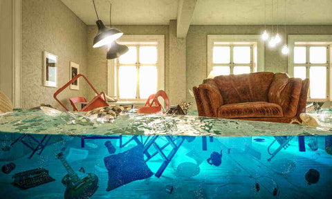 Furniture floating in a flooded living room. Bed Bug heaters are used to dry out flood damaged homes.