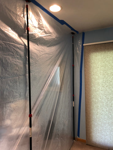 Zipwall spring loaded poles creating a temporary wall to contain bed bug heat