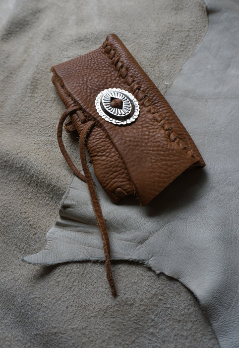 Handmade pebbled leather fringed clutch