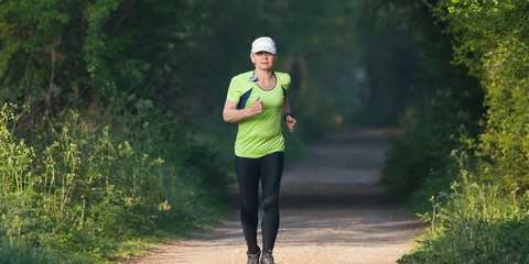 woman wearing a cap on a run