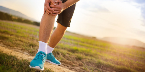 Man outside with knee pain out on a run