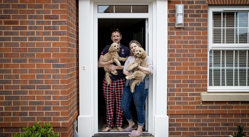 Rosie and her partner with their two dogs