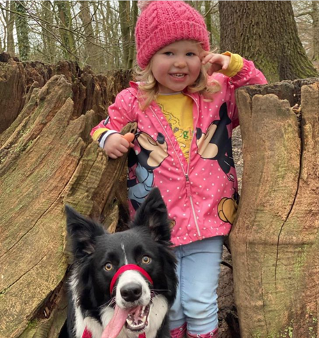 happy girl outdoors with dog