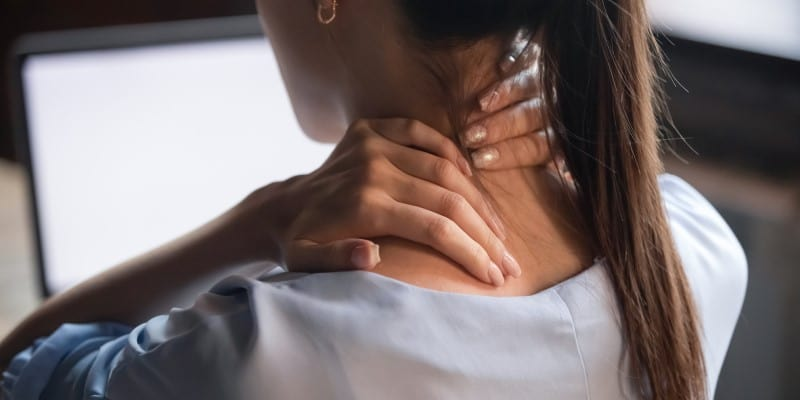 woman massaging stiff neck
