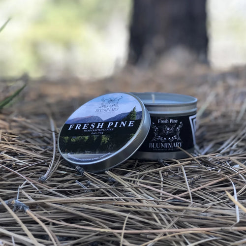 fresh pine candle lifestyle shot in woods candle