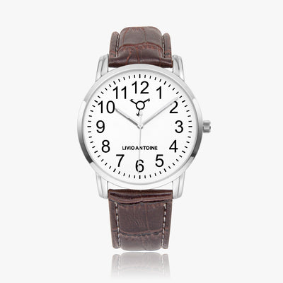 silver case, white watch face with black arabic numbers and brown leather strap