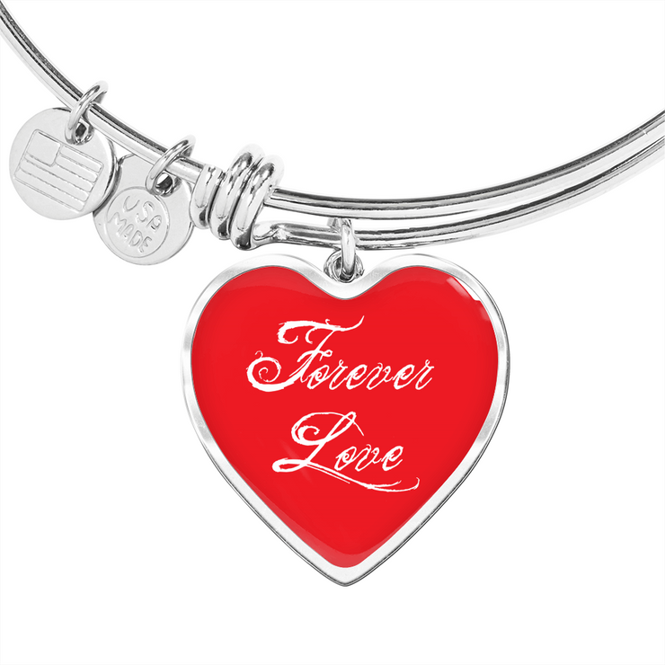 Silver bracelet with red heart and forever love written on it