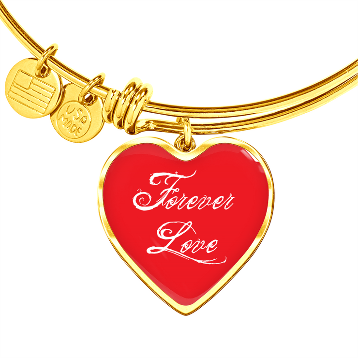 Gold bracelet with red heart and forever love written on it