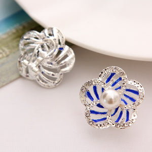 Pearl earrings on studded petals