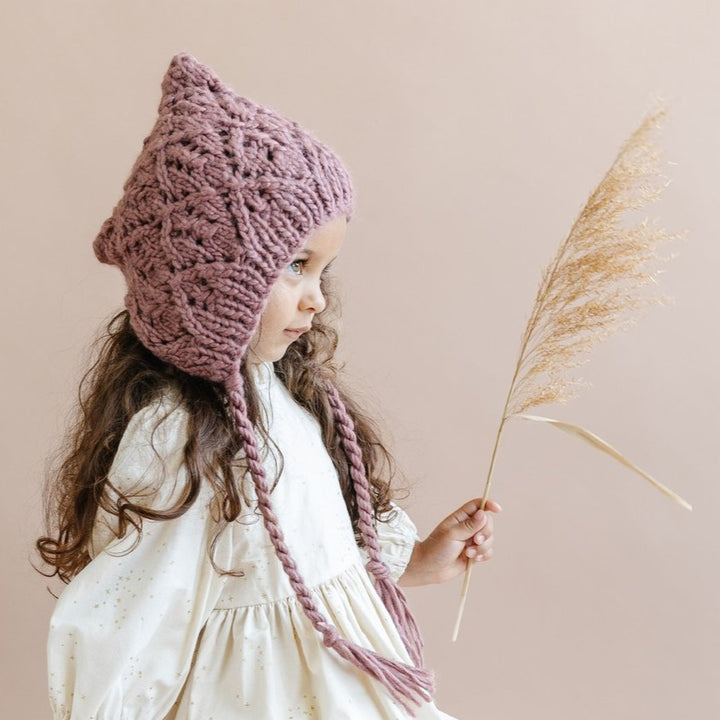 Blueberry Hill Knit Hat in Mauve - model
