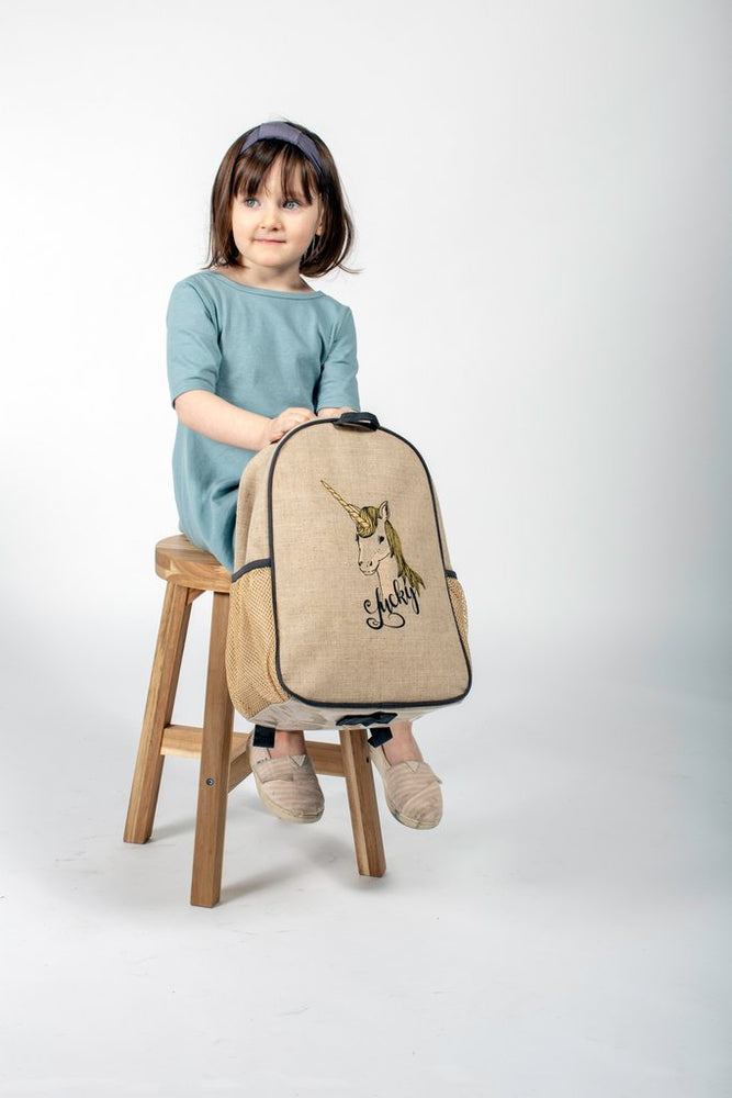 linen toddler backpack with lucky unicorn on it