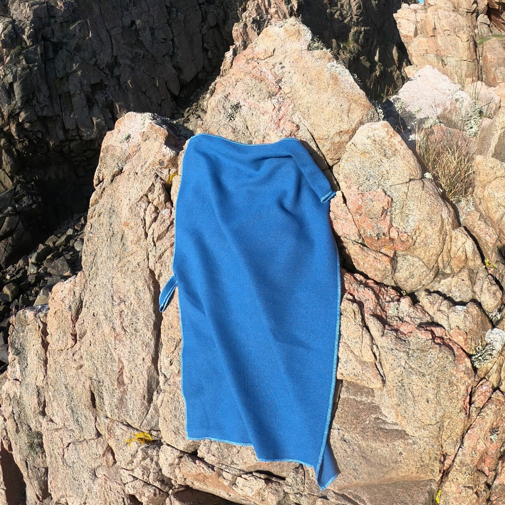 Raw Silk Travel Towel Hanging on Rock Nature Outdoors, Ensign Blue Color, Natural Biodegradable Camping Backpacking Hiking Towel, Compact Lightweight Quick Drying Antibacterial | SHIN JARDBO