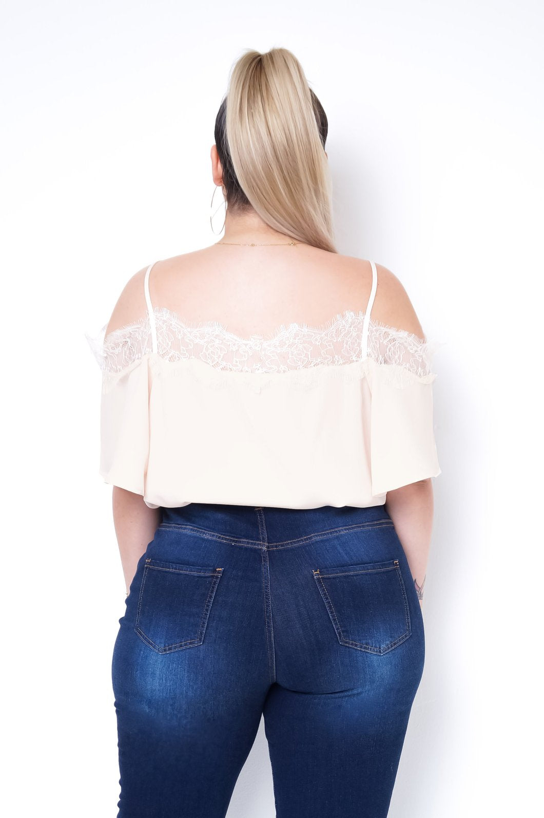 Back knee up view of a plus size model in a Beige Blossom Top